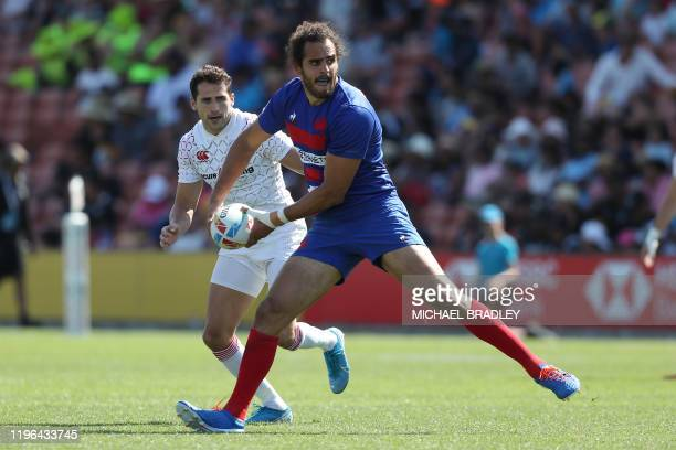 Frances Jonathan Laugel passes the ball during the men's rugby semi-final match between England and France on day two of the World Rugby Sevens...