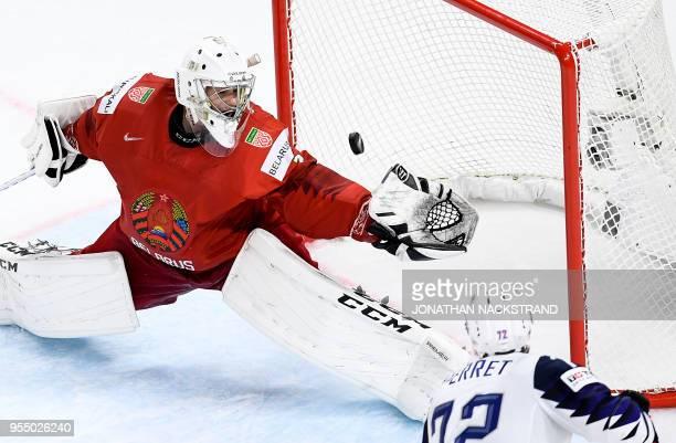France's Jordann Perret strikes to score in front of Belarus' goalie Mikhail Karnaukhov during the 2018 IIHF Men's Ice Hockey World Championship...
