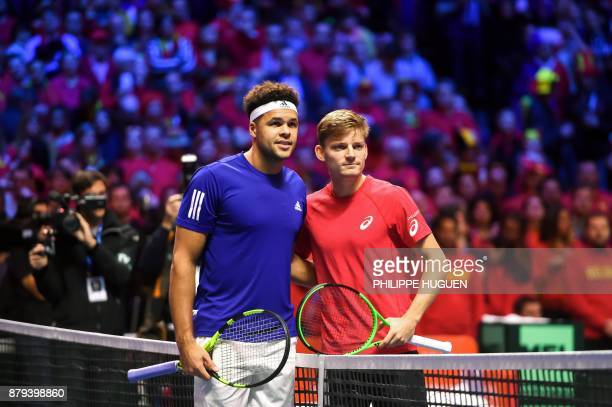 France's JoWilfried Tsonga and Belgium's David Goffin pose prior to their singles rubber 4 of the Davis Cup World Group final tennis match between...