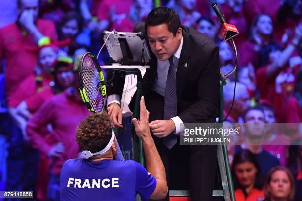 France's JoWilfried Tsonga argues a call with the umpire during his singles rubber 4 of the Davis Cup World Group final tennis match between France...