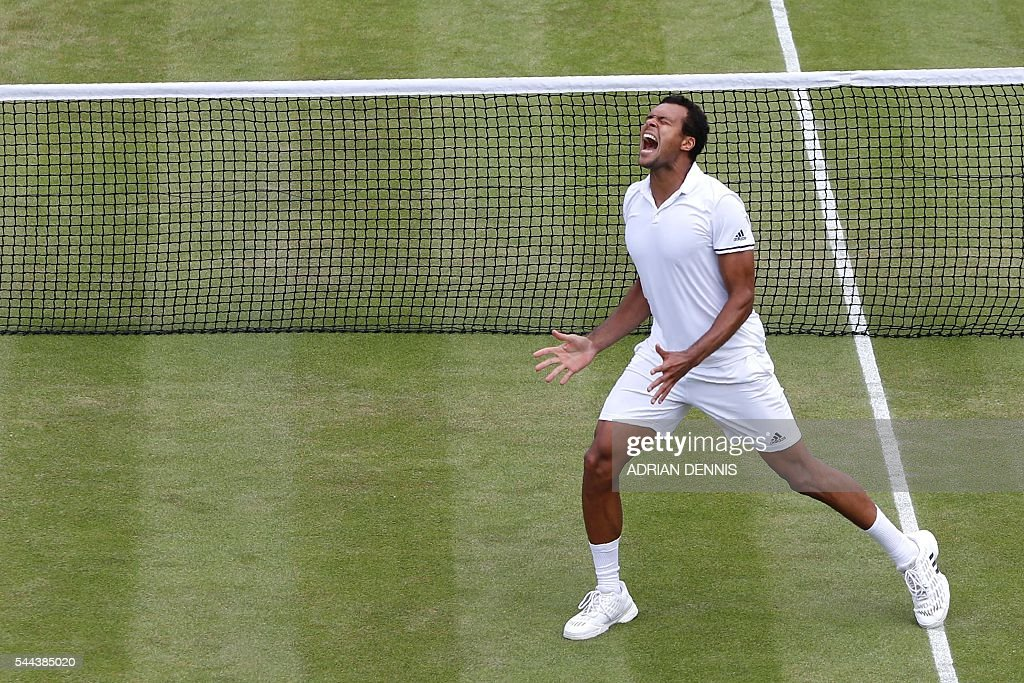 TOPSHOT - France's Jo-Wilfried Tsonga celebrates after beating US player John Isner in their men's singles third round match on the seventh day of the 2016 Wimbledon Championships at The All England Lawn Tennis Club in Wimbledon, southwest London, on July 3, 2016. / AFP / ADRIAN