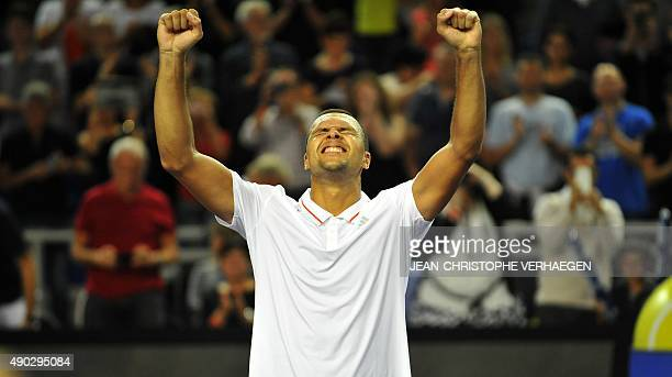 France's JoWilfried Tsonga celebrates after defeating France's Gilles Simon during the ATP Moselle Open finals tennis match on September 27 2015 in...