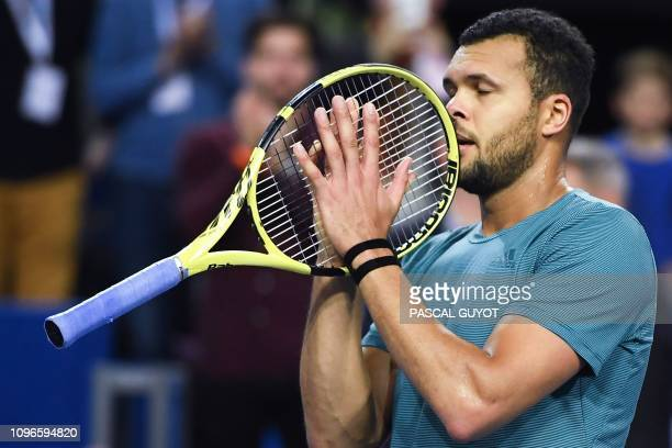 France's JoWilfried Tsonga celebrates after winning against Latvia's Radu Albot during their semifinals tennis match at the Open Sud de France ATP...