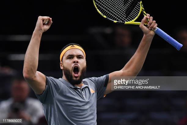 France's JoWilfried Tsonga celebrates after winning against Russia's Andrey Rublev after their men's singles tennis match on day one of the ATP World...