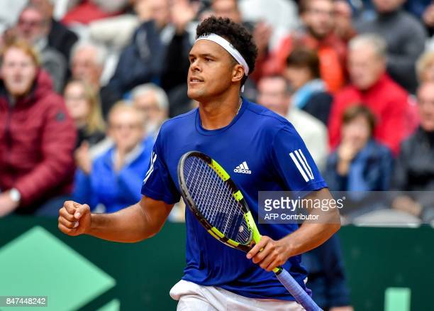 France's JoWilfried Tsonga celebrates after winning against Serbia's Laslo Djere in their singles rubber for the Davis Cup World Group semifinal...