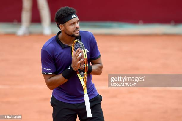 France's JoWilfried Tsonga celebrates after winning the men's singles 3rd round match against Monaco's Hugo Nys on day 4 of the ATP Challenger Tour...