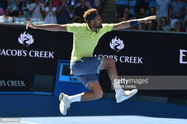 TOPSHOT France's JoWilfried Tsonga celebrates his victory against Canada's Denis Shapovalov during their men's singles second round match on day...