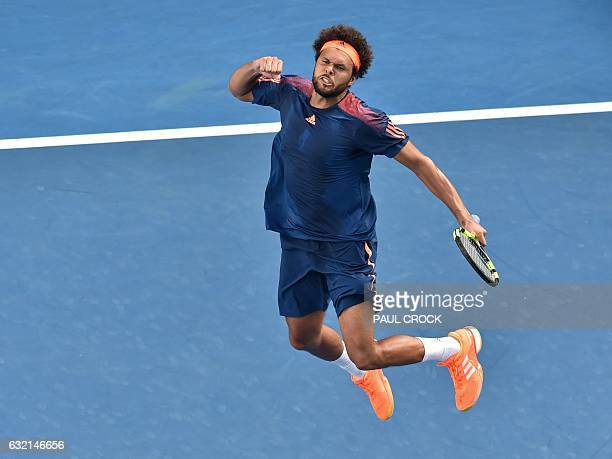 France's JoWilfried Tsonga celebrates his victory against Jack Sock of the US during their men's singles third round match on day five of the...
