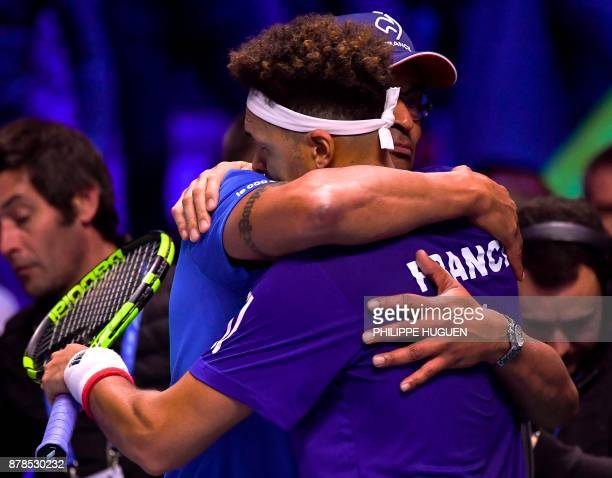 France's Jo-Wilfried Tsonga celebrates with French captain Yannick Noah after winning against Belgium's Steve Darcis during their singles rubber of...