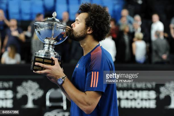 France's Jo-Wilfried Tsonga celebrates with his trophy after winning his ATP Marseille Open 13 tennis final match against France's Lucas Pouille on...