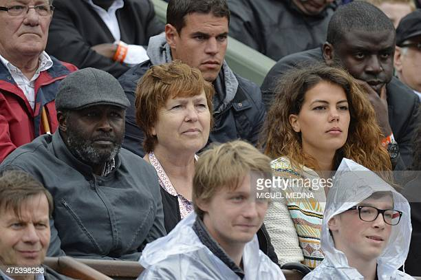 France's JoWilfried Tsonga girlfriend Noura and his parents Evelyne and Didier Tsonga watch his match against Czech Republic's Tomas Berdych during...