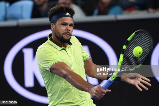 France's JoWilfried Tsonga hits a return against Kevin King of the US during their men's singles first round match on day one of the Australian Open...
