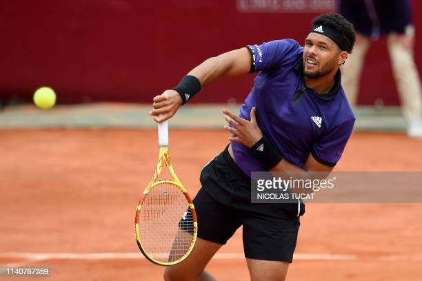 France's JoWilfried Tsonga hits a return during his men's singles 3rd round match against Monaco's Hugo Nys on day 4 of the ATP Challenger Tour...