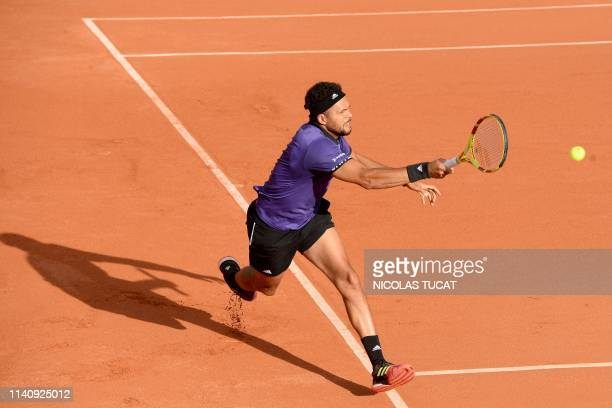 France's JoWilfried Tsonga hits a return during his men's singles quarter finals match against Slovakia's Filip Horansky on the fourth day of the ATP...