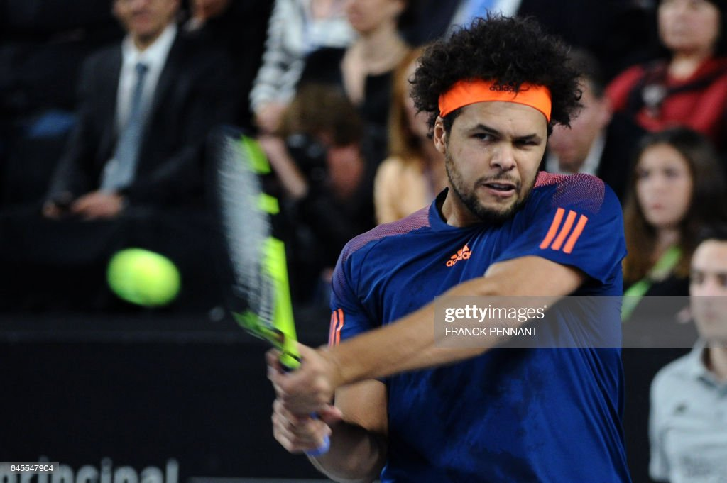 France's Jo-Wilfried Tsonga hits a return to France's Lucas Pouille during their ATP Marseille Open 13 tennis final match on February 26, 2017 in Marseille, southern France