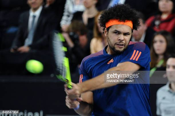 France's Jo-Wilfried Tsonga hits a return to France's Lucas Pouille during their ATP Marseille Open 13 tennis final match on February 26, 2017 in...