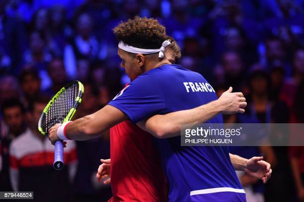 France's Jo-Wilfried Tsonga hugs Belgium's David Goffin after losing their singles rubber 4 of the Davis Cup World Group final tennis match between...