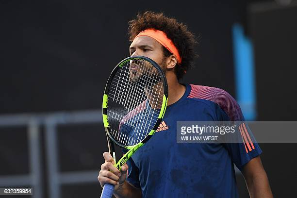 France's JoWilfried Tsonga kisses his racquet during his men's singles fourth round match against Britain's Daniel Evans on day seven of the...