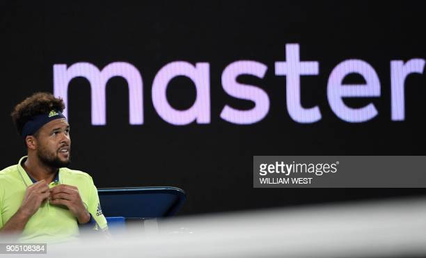 France's JoWilfried Tsonga looks up during their men's singles first round match against Kevin King of the US on day one of the Australian Open...