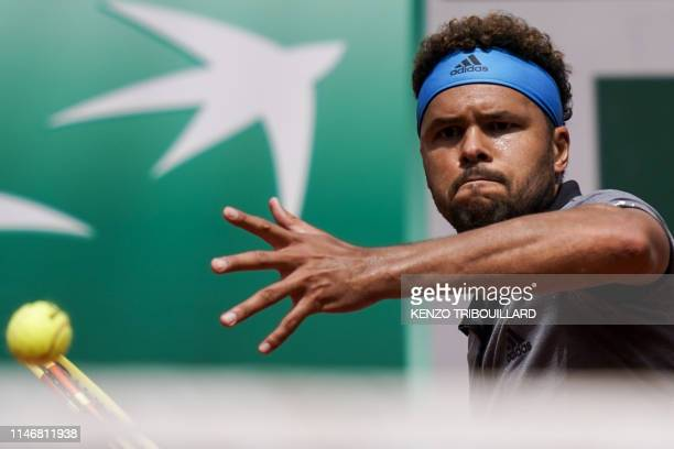 TOPSHOT France's JoWilfried Tsonga plays a forehand return to Japan's Kei Nishikori during their men's singles second round match on day four of The...