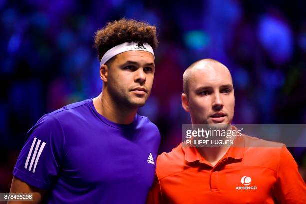 France's Jo-Wilfried Tsonga poses with Belgium's Steve Darcis during the Davis Cup World Group singles rubber final tennis match between France and...
