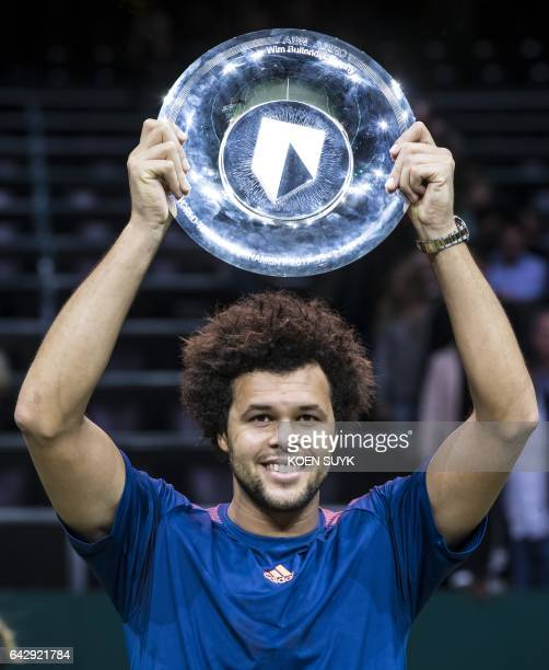 France's JoWilfried Tsonga poses with his trophy after winning the final match of the Rotterdam World Tennis Tournament against David Goffin of...