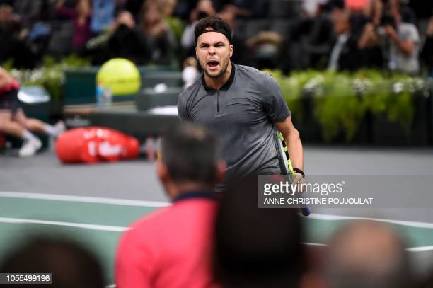 France's JoWilfried Tsonga reacts after a point against Canada's Milos Raonic during their men's singles first round match on day two of the ATP...