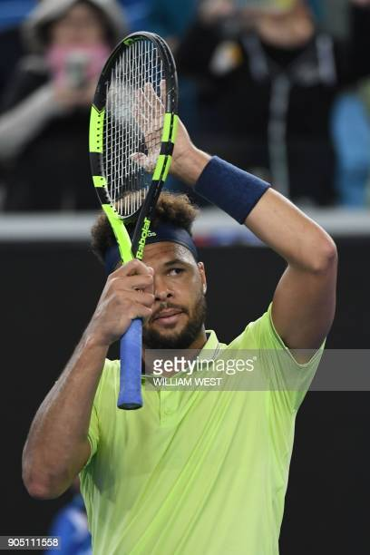France's JoWilfried Tsonga reacts after beating Jevin King of the US in their men's singles first round match on day one of the Australian Open...
