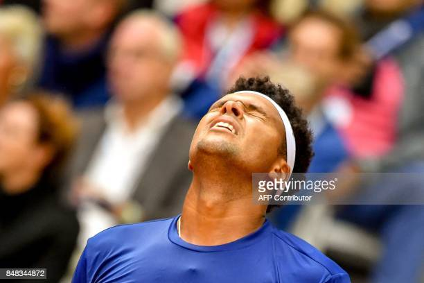 France's Jo-Wilfried Tsonga reacts after loosing a point against Serbia's Dusan Lajovic during their Davis Cup world group semi-final tennis match...