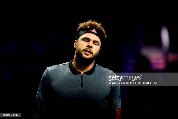 France's JoWilfried Tsonga reacts after losing a point against Germany's Peter Gojowczyk during their ATP Moselle Open first round tennis match on...