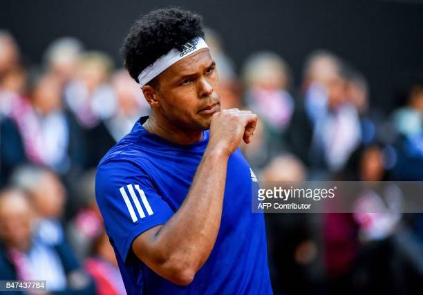 France's Jo-Wilfried Tsonga reacts after winning a point against Serbia's Laslo Djere during their singles rubber for the Davis Cup World Group...