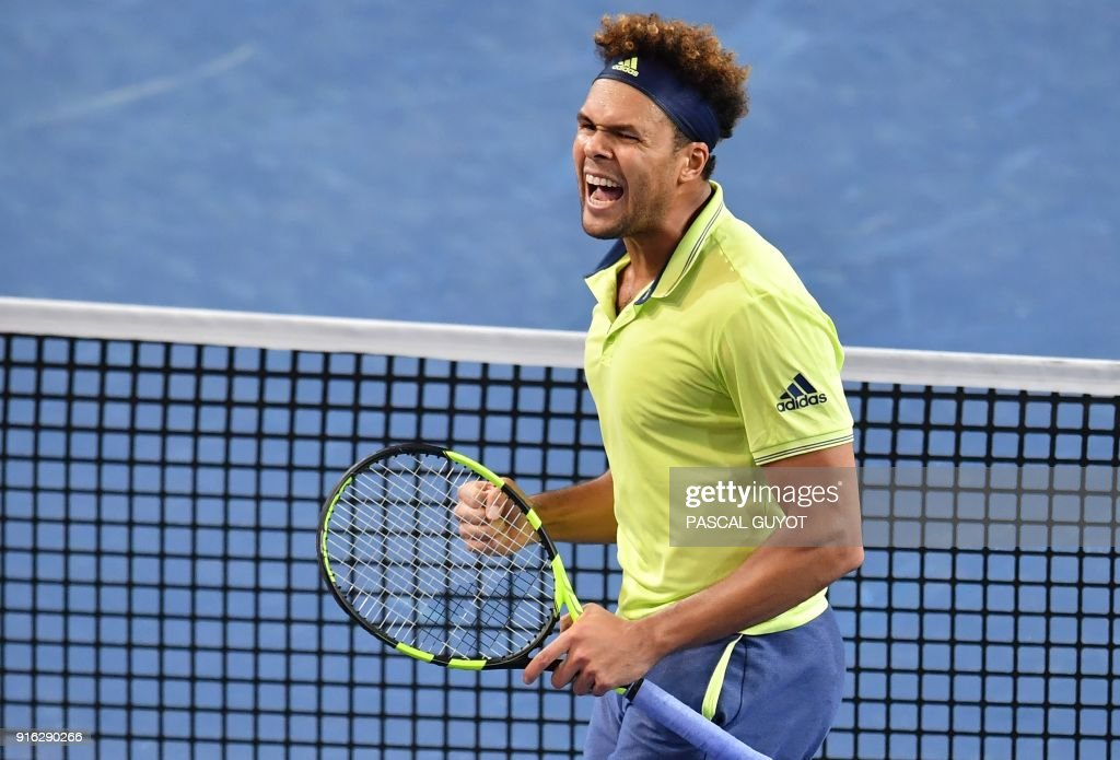 France's Jo-Wilfried Tsonga reacts after winning a point against Russia's Andrey Rublev during their quarter-final singles tennis match at the Open Sud de France ATP World Tour in Montpellier, southern France on February 9, 2018. /