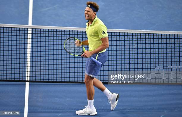France's JoWilfried Tsonga reacts after winning a point against Russia's Andrey Rublev during their quarterfinal singles tennis match at the Open Sud...