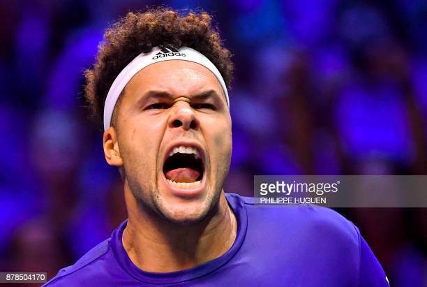 France's Jo-Wilfried Tsonga reacts after winning a point against Belgium's Steve Darcis during the Davis Cup World Group singles rubber final tennis...