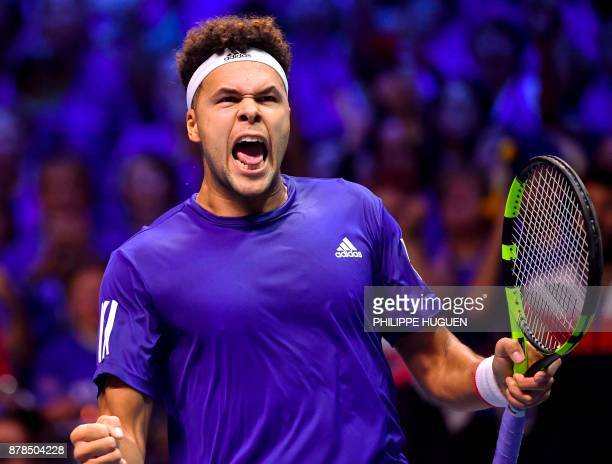 France's JoWilfried Tsonga reacts after winning a point against Belgium's Steve Darcis during the Davis Cup World Group singles rubber final tennis...