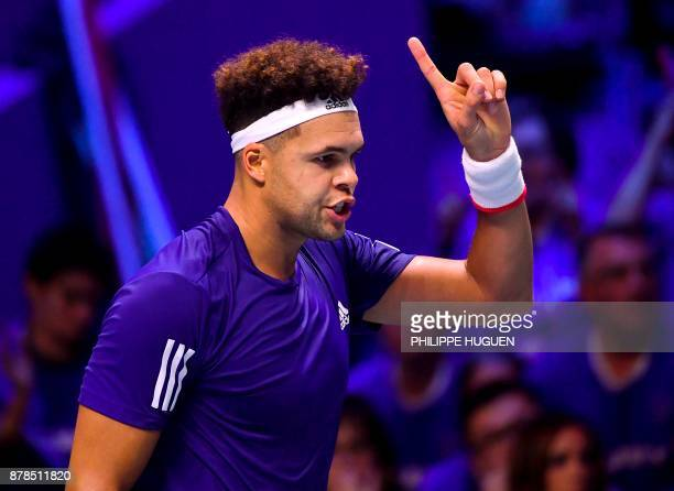 France's Jo-Wilfried Tsonga reacts after winning a point against to Belgium's Steve Darcis during their singles rubber of the Davis Cup World Group...