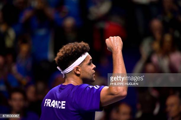 France's Jo-Wilfried Tsonga reacts after winning against Belgium's Steve Darcis during their singles rubber of the Davis Cup World Group final tennis...