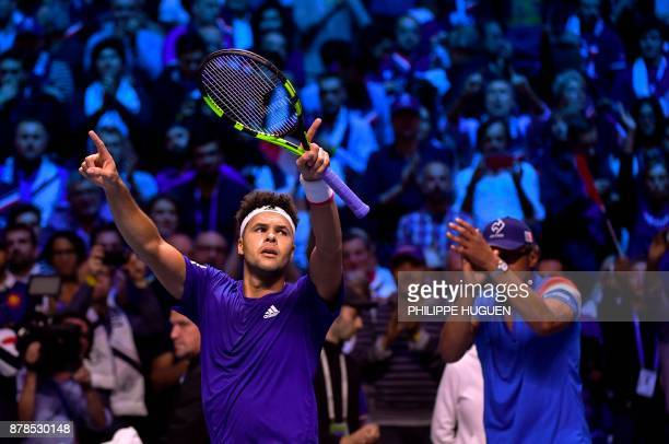 France's JoWilfried Tsonga reacts after winning against Belgium's Steve Darcis during their singles rubber of the Davis Cup World Group final tennis...