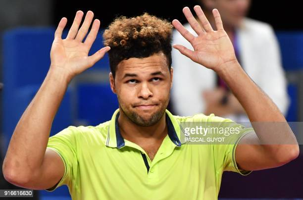 France's JoWilfried Tsonga reacts as he withdraws against France's Lucas Pouille during their semi final tennis match at the Open Sud de France ATP...
