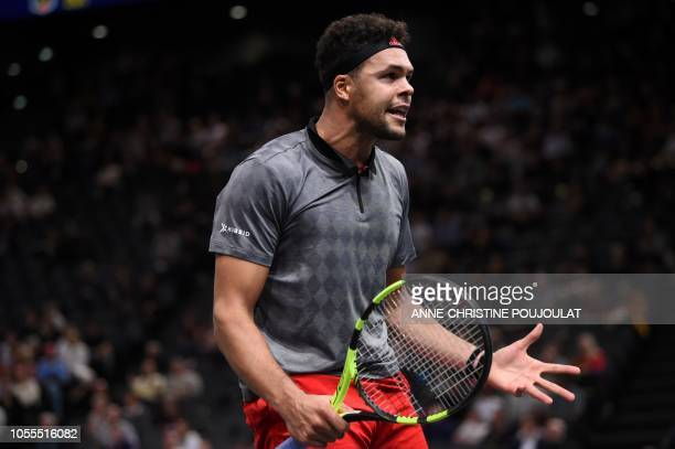 TOPSHOT France's JoWilfried Tsonga reacts at the end of his men's singles first round match against Canada's Milos Raonic on day two of the ATP World...