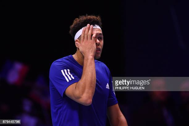 France's Jo-Wilfried Tsonga reacts during his singles rubber 4 of the Davis Cup World Group final tennis match between France and Belgium at The...