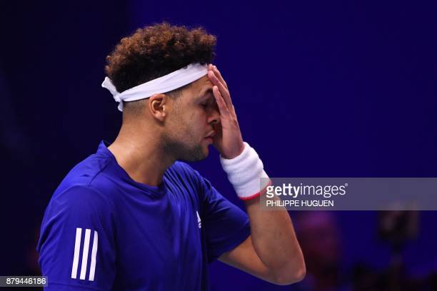 France's JoWilfried Tsonga reacts during his singles rubber 4 of the Davis Cup World Group final tennis match between France and Belgium at The...