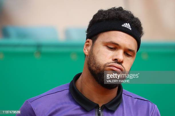 France's JoWilfried Tsonga reacts during his tennis match against US Taylor Fritz on the day 4 of the MonteCarlo ATP Masters Series tournament on...