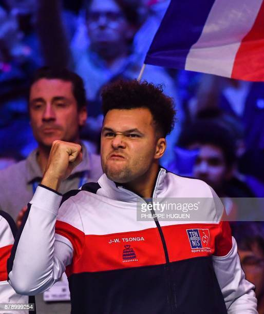 France's JoWilfried Tsonga reacts during the doubles tennis match at the Davis Cup World Group final between France and Belgium at Pierre Mauroy...