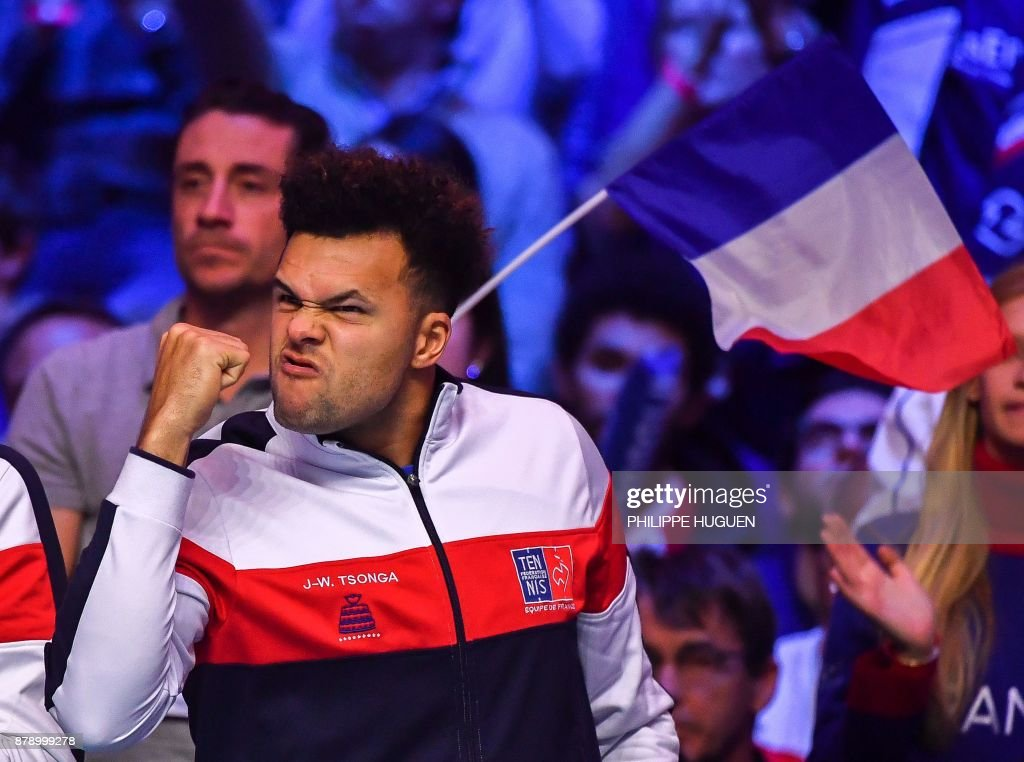 TOPSHOT - France's Jo-Wilfried Tsonga reacts during the doubles tennis match at the Davis Cup World Group final between France and Belgium at Pierre Mauroy Stadium in Lille on November 25, 2017. /