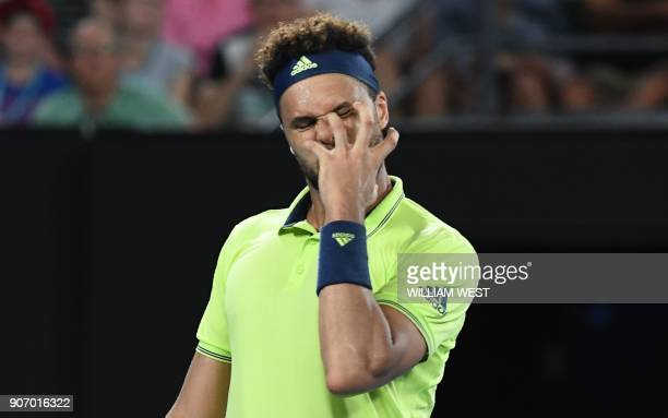 France's JoWilfried Tsonga reacts during their men's singles third round match against Australia's Nick Kyrgios on day five of the Australian Open...