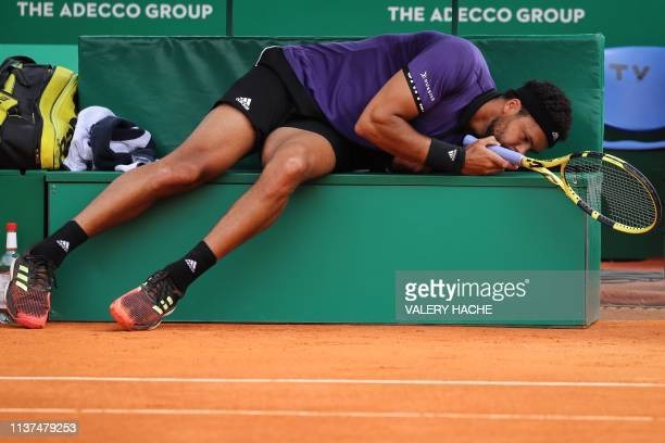 TOPSHOT France's JoWilfried Tsonga reacts on the bench during his tennis match against US Taylor Fritz on the day 4 of the MonteCarlo ATP Masters...