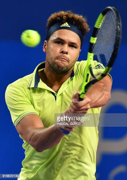 France's JoWilfried Tsonga returns against France's Lucas Pouille during their semi final tennis match at the Open Sud de France ATP World Tour in...