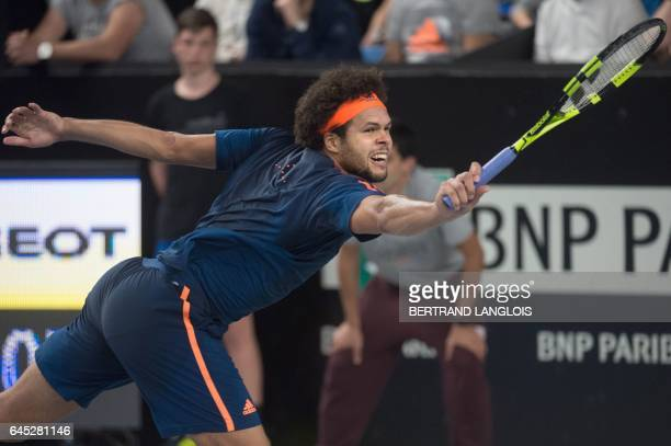 France's Jo-Wilfried Tsonga returns the ball to Australia's Nick Kyrgios during their ATP Marseille Open 13 semi-final tennis match in Marseille,...