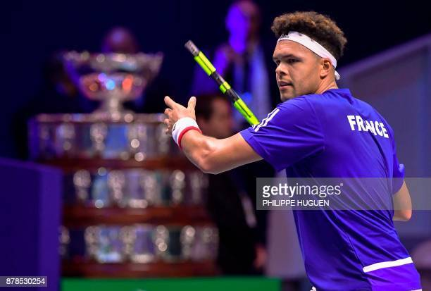France's JoWilfried Tsonga returns the ball to Belgium's Steve Darcis during their singles rubber of the Davis Cup World Group final tennis match...